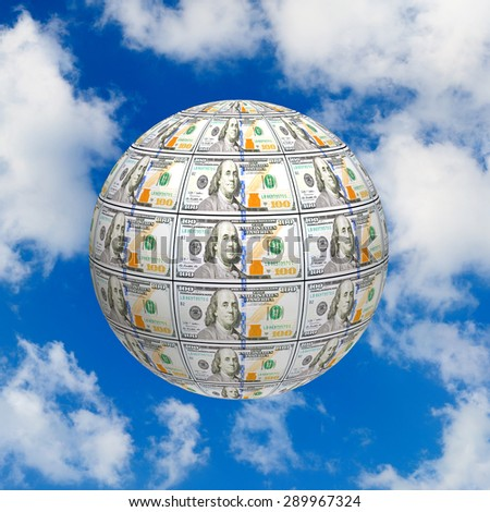 stylized image of the globe made of banknotes on the sky background - stock photo