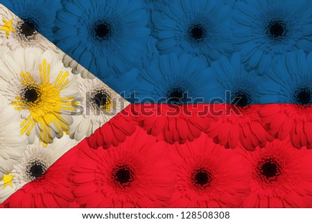 stylized national flag of philippines with gerbera daisy flowers as concept and symbol of love, beauty, innocence, and positive emotions - stock photo