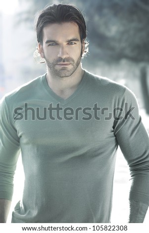 Stylized outdoor portrait of a beautiful man - stock photo