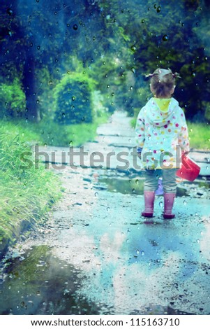 stylized photo of little girl's back and rain drops - stock photo