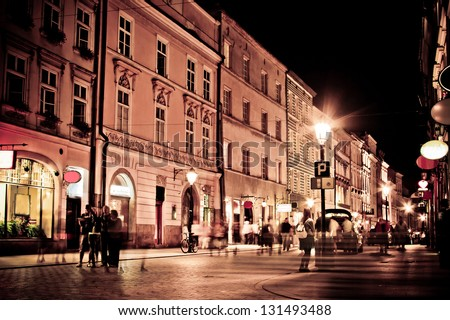 stylized photo of the city's old street in the night - stock photo