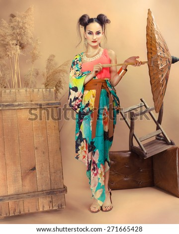 Stylized portrait of a Japanese geisha with bright make up  - stock photo
