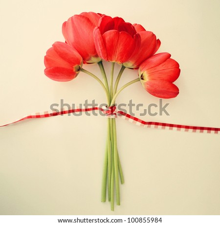 Stylized vintage card with beautiful red tulips and bow - stock photo