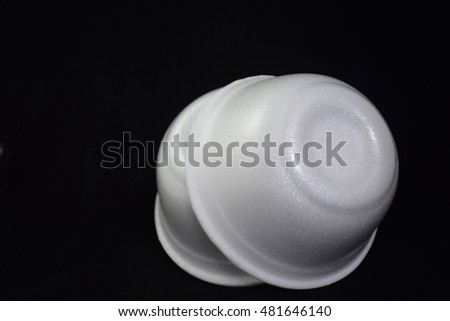 Styrofoam bowl against black background.