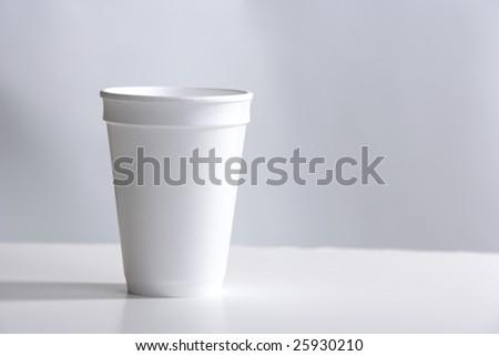 Styrofoam Cup on desk - stock photo