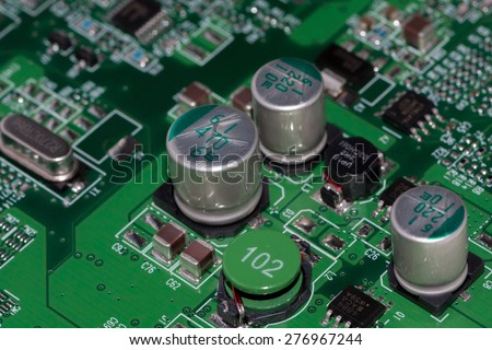 sub system mounted on a printed wiring board with integrated circuits, electrolytic capacitors, chip capacitors (smd), chip resistors (smd), coils, and other components  - stock photo