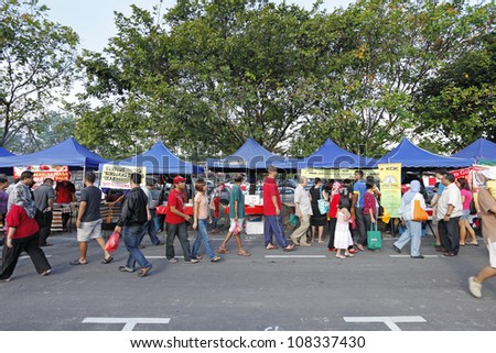 SUBANG JAYA, MALAYSIA - JULY 22: Shoppers at a Ramadan food bazaar on July 22, 2012 in Subang Jaya, Malaysia. The food bazaar is established for muslim to break fast during the holy month of Ramadan. - stock photo