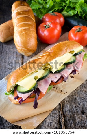 Submarine sandwich with cheese and ham.Selective focus on the front sandwich - stock photo