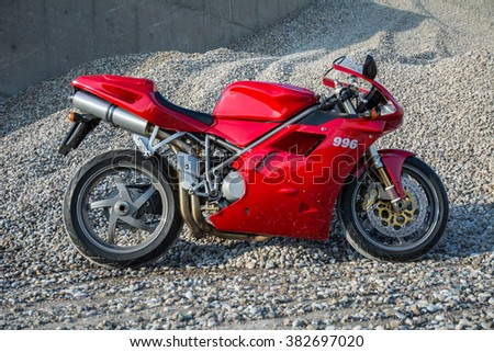 Subotica, Serbia: February 20th, 2016. Closeup of beautiful red Ducati 996s motorcycle, photographed outdoor on a nice sunny day.