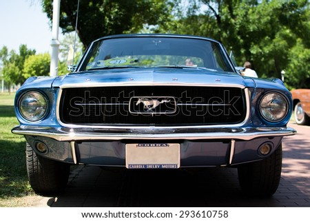 Subotica,Serbia -July 05,2015:Ford Mustang 289 edelbrock on Annual oldtimer car show Subotica 2015.Various vintage cars and motorcycles.In organization of Oldtimer Club.Selective focus on horse badge. - stock photo