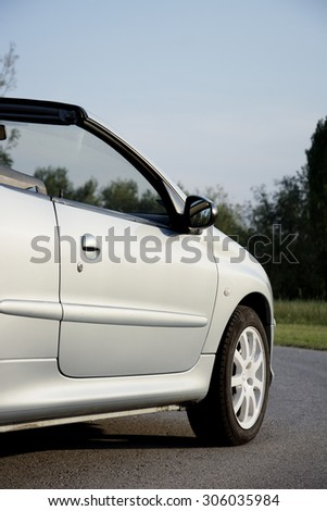 Subotica, Serbia, July 23, 2015: Photo shooting of a convertible Peugeot 206 cc car, with roof down in rural settings.