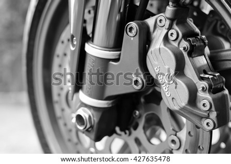 Subotica, Serbia May 27th 2016: Close up of front wheel and brakes of Ducati 996s motorcycle, photographed outdoors on a nice sunny day in a home backyard.