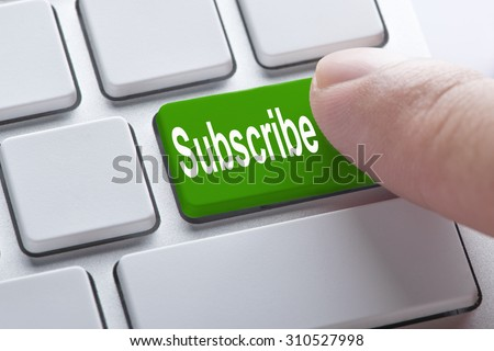 Subscribe green button on keyboard, business concept
