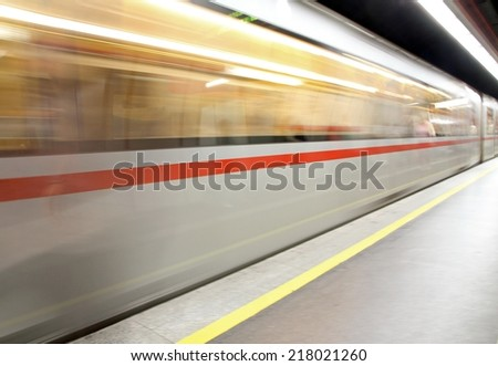 subterranean subway car arriving at the train station - stock photo