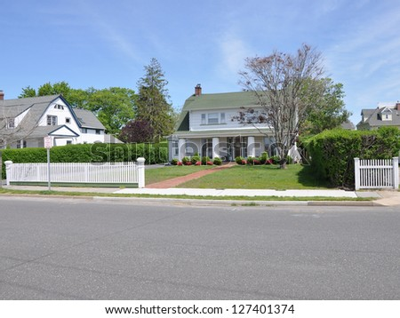 Suburban Colonial Home White Picket Fence - stock photo