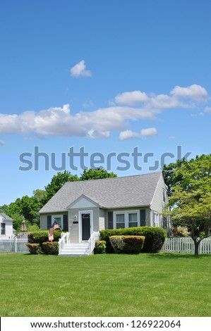 Suburban Cottage Style  American Home Front Yard Lawn Sunny Blue Sky - stock photo