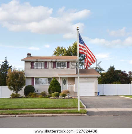 Suburban High Ranch Home American Flag Pole curbside blue sky clouds residential neighborhood USA - stock photo