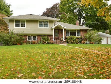 Suburban High Ranch Style Home Autumn Fall Day residential neighborhood overcast sky USA