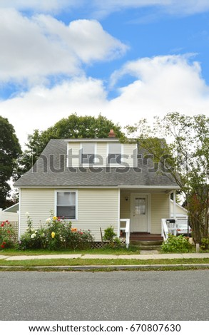 Suburban home bungalow style house blue sky clouds USA