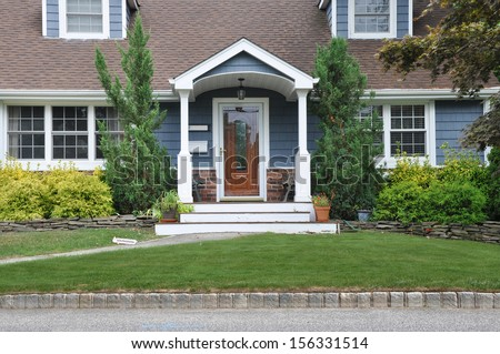 Suburban Home Cape Cod Style Architecture Entrance front Yard USA Residential Neighborhood - stock photo