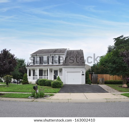 Suburban Home Driveway Way Mailbox Flowers Landscaped Front Yard Residential Neighborhood Blue Sky Clouds USA - stock photo