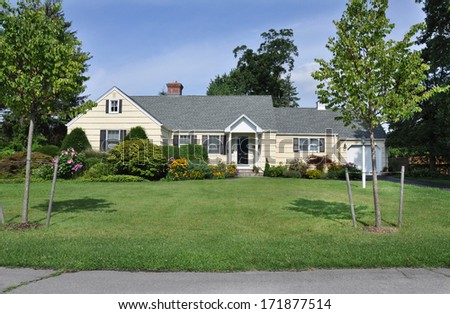 Suburban home landscaped plants flowers trees residential neighborhood usa - stock photo