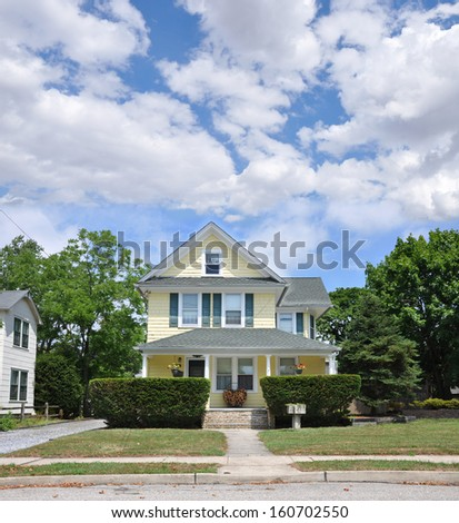 Suburban Home Pebble Steps Chopped Wood on Porch Sunny Residential Neighborhood USA - stock photo