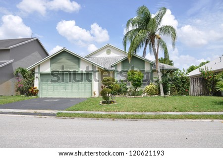Suburban Home Snout Back Split Architecture Residential Neighborhood Blue Sky Clouds
