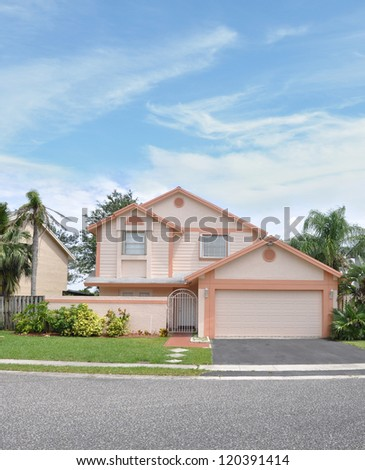 Suburban Home Snout Style Back Split House residential neighborhood blue sky clouds