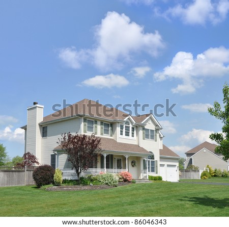Suburban Home Two Story Two Car Garage Trees Flowers Sunny Blue Sky Day
