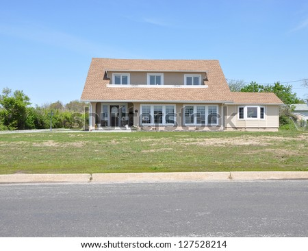 Suburban Home with Balding Grass Spot Front Yard Lawn - stock photo