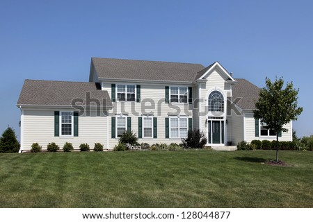 Suburban home with green shutters