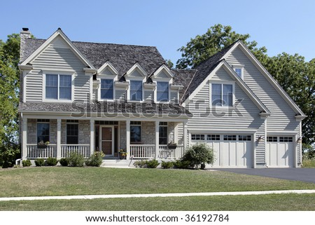 Suburban home with porch and cedar roof