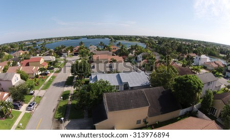 Suburban homes and street in Florida seen from above - stock photo