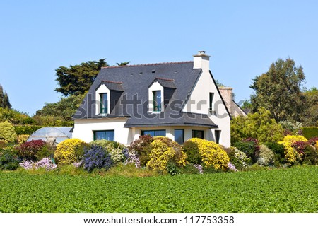 Suburban House in Western France with blooming garden - stock photo