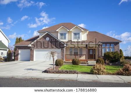 suburban house on a beautiful sunny day  - stock photo