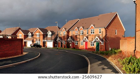 suburban housing estate. cul-de-sac in cannock in england with starter home town houses - stock photo