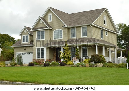Suburban McMansion style home overcast cloudy day residential neighborhood USA - stock photo