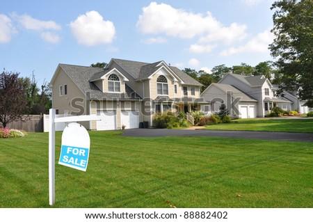 Suburban Neighborhood Home Realtor Sign on Front Yard Lawn Sunny Blue Cloud Sky Day - stock photo