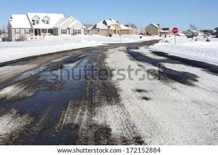 Suburban neighborhood in winter - stock photo