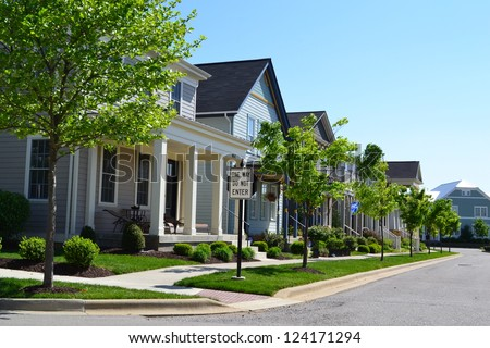 Suburban Neighborhood of New England Style American Dream Homes - stock photo