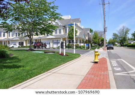 Suburban Neighborhood Sidewalk Street Sunny Blue Sky Day - stock photo
