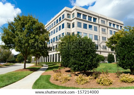 Suburban office building in a generic parkway setting  - stock photo