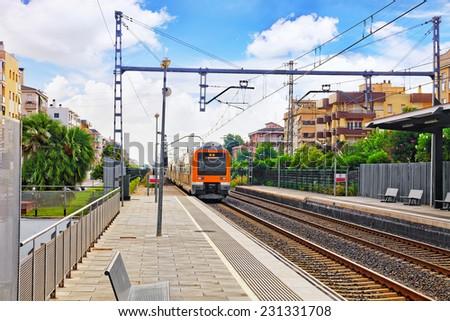 Suburban railway train at the railways stantion. - stock photo