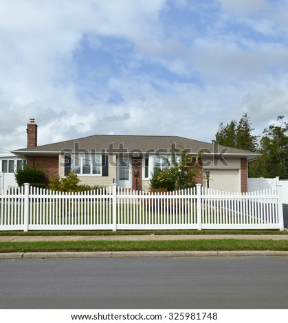 Suburban Ranch Home White Picket Fence residential neighborhood USA Blue Sky Clouds - stock photo