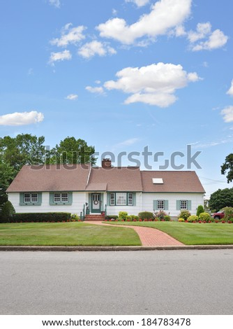 Suburban Ranch style home landscaped lawn brick walkway skylight window blue sky clouds usa residential neighborhood  - stock photo