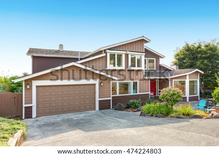 Suburban residential luxury house on Blue sky background. Northwest, USA