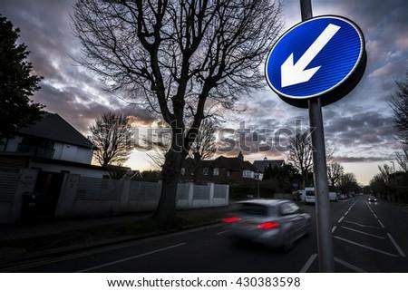Suburban road at dusk - stock photo