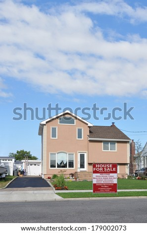 Suburban Tan Home Landscaped Lawn Residential Neighborhood Blue Sky Clouds USA