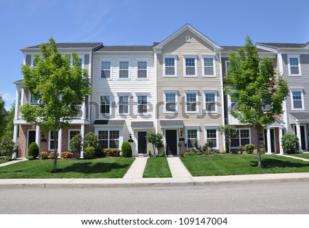 Suburban Three story Town Homes Sunny Blue Sky Day - stock photo